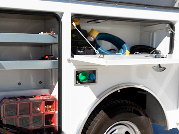 CM Truck Beds Gen2 Service Body in parking lot with tool boxes open